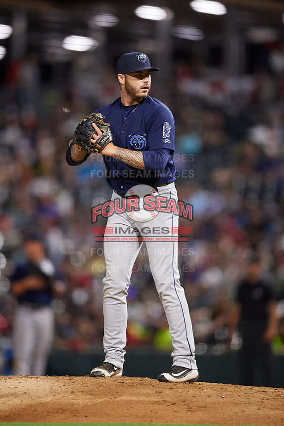 Mobile BayBears relief pitcher Sean Isaac (37) gets ready to deliver a pitch during a game against the Jacksonville Jumbo Shrimp on April 14, 2018 at Baseball Grounds of Jacksonville in Jacksonville, Florida.  Mobile defeated Jacksonville 13-3.  (Mike Janes/Four Seam Images)