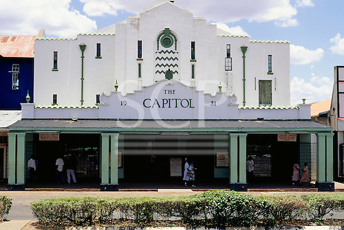 Livingstone, Victoria Falls, Zambia. The Capitol, a small office and shop building painted white.