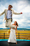 Bride and groom on trampoline during formals in Steamboat Springs Colorado.