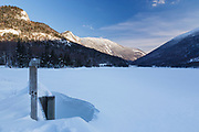 Franconia Notch State Park with Echo Lake in the foreground during the winter months. Located in the White Mountains, New Hampshire USA