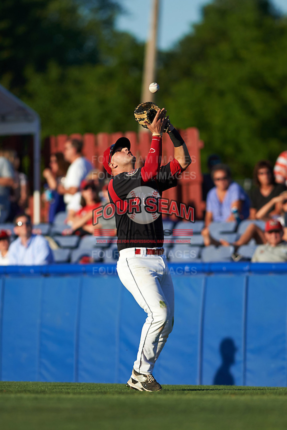 Batavia Muckdogs first baseman Ryan Cranmer (12) catches a popup during a game against the Vermont Lake Monsters August 9, 2015 at Dwyer Stadium in Batavia, New York.  Vermont defeated Batavia 11-5.  (Mike Janes/Four Seam Images)