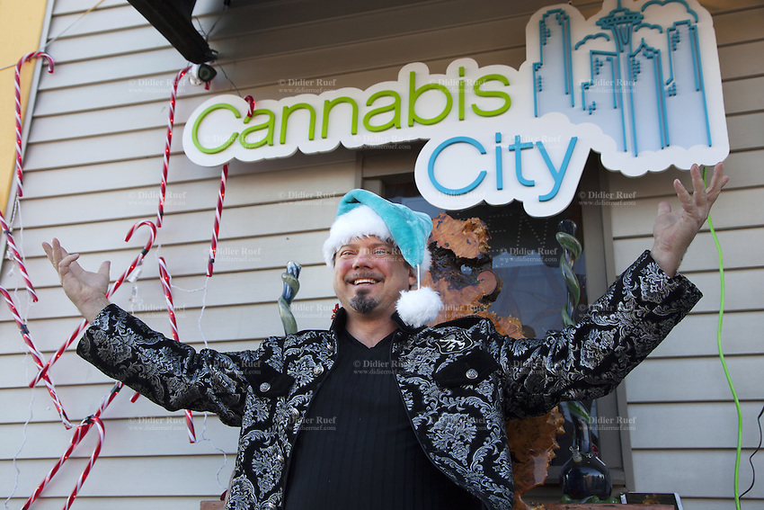 USA. Washington state. Seattle. James Lathrop is the owner of Cannabis City. Cannabis City is authorized, according to cannabis legalization in Washington State, to sell marijuana as a retail store front. Cannabis City was the first state-licensed store for recreational marijuana open in July 2014. Cannabis, commonly known as marijuana, is a preparation of the Cannabis plant intended for use as a psychoactive drug and as medicine. Pharmacologically, the principal psychoactive constituent of cannabis is tetrahydrocannabinol (THC); it is one of 483 known compounds in the plant, including at least 84 other cannabinoids, such as cannabidiol (CBD), cannabinol (CBN), tetrahydrocannabivarin (THCV), and cannabigerol (CBG). 14.12.2014 © 2014 Didier Ruef