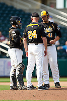 Charlie Lowell (41) of the Wichita State Shockers talks with Catcher Chris O' Brien (22) and Coach Brent Kemnitz (24) on the mound during a game against the Missouri State Bears on April 9, 2011 at Hammons Field in Springfield, Missouri.  Photo By David Welker/Four Seam Images
