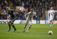 Tommy Carroll of Tottenham Hotspur turns Richard Almeida of Qarabag FK during the UEFA Europa League match between Tottenham Hotspur and Qarabag FK at White Hart Lane, London, England on 17 September 2015. Photo by Andy Rowland.