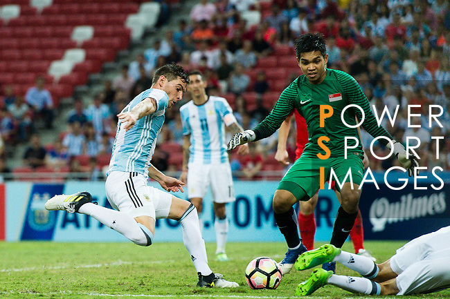 Lucas Alario of Argentina (L) attempts a kick while being defended by Izwan Mahbud of Singapore (R) during the International Test match between Argentina and Singapore at National Stadium on June 13, 2017 in Singapore. Photo by Marcio Rodrigo Machado / Power Sport Images