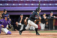 Shortstop Buddy Mrowka (5) of the Harvard Crimson bats in game two of a doubleheader against the Furman Paladins on Friday, March 16, 2018, at Latham Baseball Stadium on the Furman University campus in Greenville, South Carolina. The catcher is John Michael Boswell. Furman won, 7-6. (Tom Priddy/Four Seam Images)