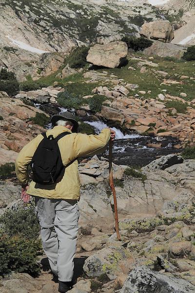 Man hiking in Indian Peaks Wilderness Area, west of Boulder, Colorado.