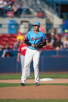 Spokane Indians relief pitcher Francisco Villegas (16) gets ready to deliver a pitch during a Northwest League game against the Vancouver Canadians at Avista Stadium on September 2, 2018 in Spokane, Washington. The Spokane Indians defeated the Vancouver Canadians by a score of 3-1. (Zachary Lucy/Four Seam Images)