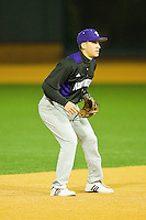 Shortstop Kyle Ruchim #9 of the Northwestern Wildcats on defense against the Wake Forest Demon Deacons at Gene Hooks Field on February 26, 2011 in Winston-Salem, North Carolina.  Photo by Brian Westerholt / Four Seam Images