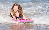 Avon, Outer Banks, North Carolina.  Teenage Girl Boogie Boarding.