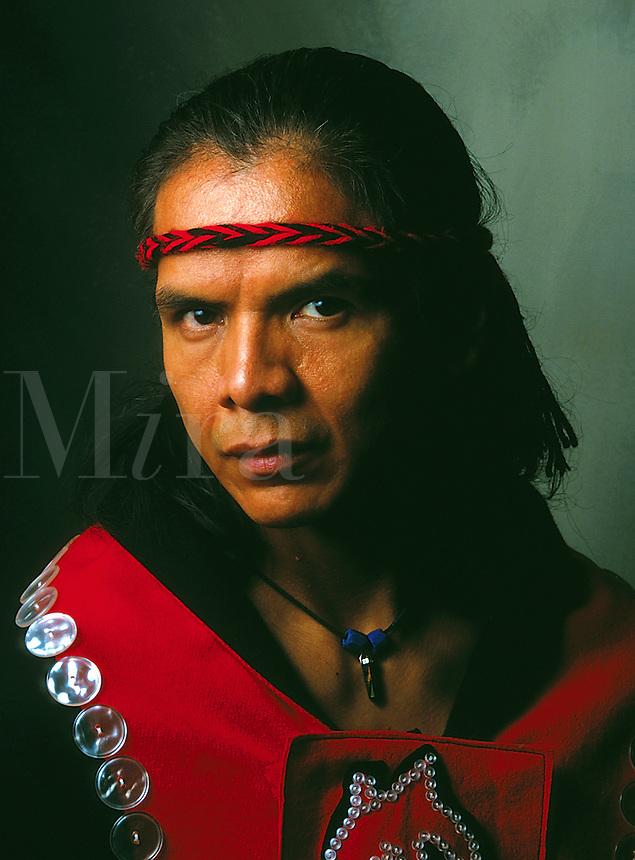 Portrait of a Native Alaskan Tlingit man wearing a traditional button blanket. Alaska.