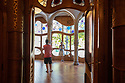 Spain - Barcelona - A Catalan couple is seen photographing itself inside the famous Casa Batlló, the masterpiece. During the past 20 years the Casa Batlló was so overcrowded with tourists that Barcelonians had given up visiting it.
