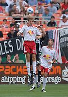 New York Red Bulls midfielder Dave Van Den Bergh (11) goes up for a header over DC United defender Bryan Namoff (26). DC United defeated the New York Red Bulls, 4-2, at RFK Stadium in Washington DC, Sunday, June 10, 2007.