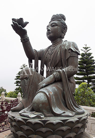 One of the sculptures surrounding the Tian Tan Buddha on Lantau Island, which depict the Offering of the Six Devas.