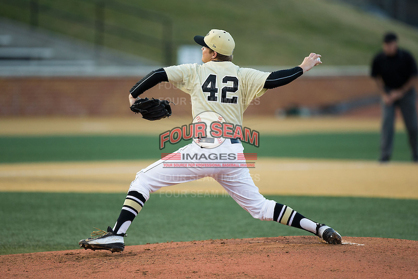 Wake Forest Demon Deacons relief pitcher Paul Kirkpatrick (42) delivers a pitch to the plate against the UConn Huskies at Wake Forest Baseball Park on March 17, 2015 in Winston-Salem, North Carolina.  The Demon Deacons defeated the Huskies 6-2.  (Brian Westerholt/Four Seam Images)