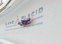 5 December 2014:  Tristan Walker and Justin Snith, sliding for Canada, bank into Curve 10 on their second run, ending the day with a 9th place finish and a combined 2-run time of 1:28.677 in the Men's Doubles Competition at the Viessmann Luge World Cup, at the Olympic Sports Track in Lake Placid, New York, USA. Mandatory Credit: Ed Wolfstein Photo *** RAW (NEF) Image File Available ***