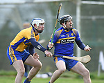 Aidan Quilligan of  Sixmilebridge  in action against Colin Ryan of Newmarket during their Clare Champion Cup final at Clonlara. Photograph by John Kelly.