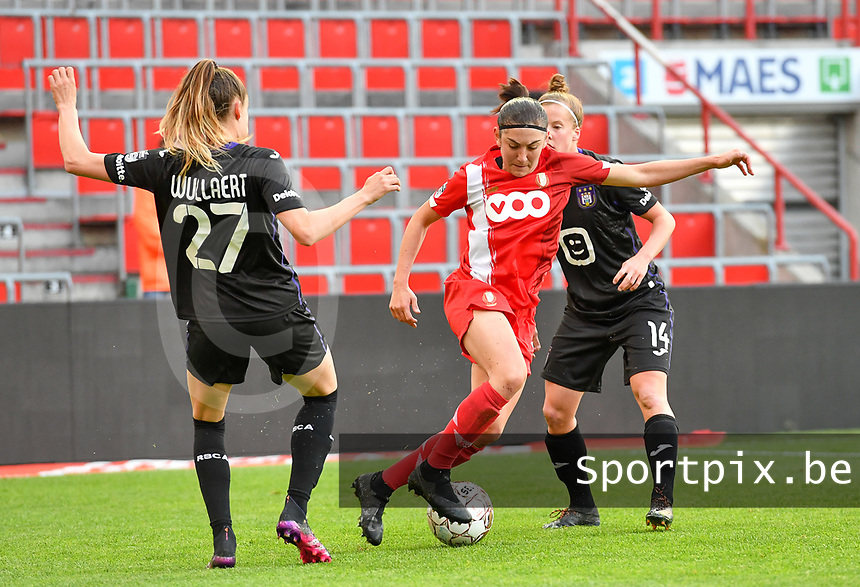 Tessa Wullaert (27) of Anderlecht pictured in a duel with Noemie Gelders (10) of Standard and Laura Deloose (14) of Anderlecht during a female soccer game between Standard Femina de Liege and RSC Anderlecht on the 8th matchday in play off 1 of the 2020 - 2021 season of Belgian Scooore Womens Super League , tuesday 18 th of May 2021  in Angleur , Belgium . PHOTO SPORTPIX.BE | SPP | DAVID CATRY