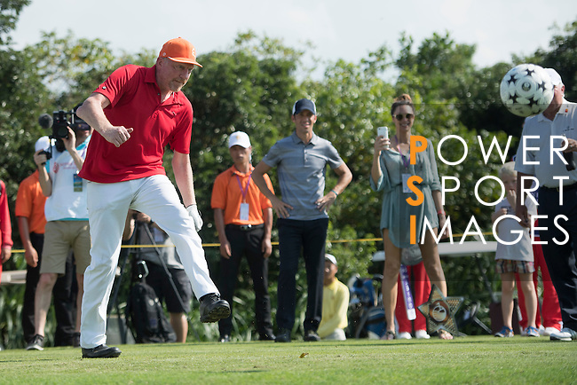Boris Becker kicks a football at the 14th hole during the World Celebrity Pro-Am 2016 Mission Hills China Golf Tournament on 22 October 2016, in Haikou, China. Photo by Weixiang Lim / Power Sport Images