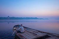 Fog rising over the Yamuna River near the Taj Mahal, Agra India
