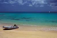 inflatable boat (sailboat tender) on beach Matthew Town, Great Inagua Island Southern Ba, Caribbean, Atlantichamas