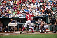 Tyler Spoon (8) of the Arkansas Razorbacks bats during a game between the Virginia Cavaliers and Arkansas Razorbacks at TD Ameritrade Park on June 13, 2015 in Omaha, Nebraska. (Brace Hemmelgarn/Four Seam Images)