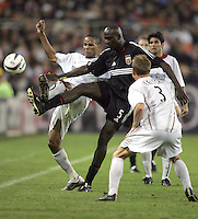 30 October,  2004.   DC United's Ezra Hendrickson (5) tries to keep the ball from the MetroStars' Ricardo Clark (2) and Chris Leitch (3) during the 2004 MLS playoffs at RFK Stadium in Washington, DC.