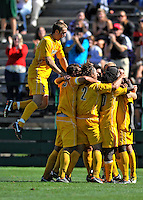 18 September 2011: University of Vermont Catamount Midfielder Brad Cole (left), a Sophomore from South Burlington, VT, jumps towards his teammates after a win over the Harvard University Crimson at Centennial Field in Burlington, Vermont. The Catamounts shut out the visiting Crimson 1-0, earning their 3rd straight victory of the 2011 season. Mandatory Credit: Ed Wolfstein Photo
