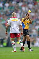 Joe Marler of Harlequins receives a yellow card from referee Greg Garner during the Premiership Rugby Round 1 match between London Irish and Harlequins at Twickenham Stadium on Saturday 6th September 2014 (Photo by Rob Munro)