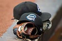 Syracuse Chiefs hats sit on top of baseball gloves in the visitors dugout during the International League game against the Charlotte Knights at Knights Stadium on August 29, 2012 in Fort Mill, South Carolina.  (Brian Westerholt/Four Seam Images)