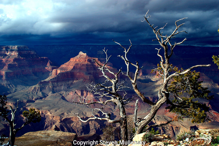 Storm clouds roll in to cover the Grand Canyon in this view from the South Rim.