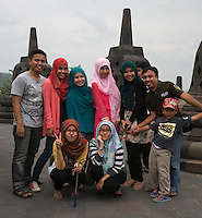 Borobudur, Java, Indonesia.  Group of Indonesian Tourists Posing for their Picture.