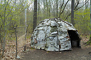 A wigwam at Sandy Point Discovery center in Stratham, New Hampshire. Wigwams are dome-shaped huts or tents that were used by Native American tribes.