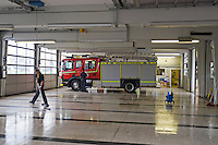 Firefighters cleaning Appliance Bay and Fire Engine Warwickshire UK. This image may only be used to portray the subject in a positive manner..©shoutpictures.com..john@shoutpictures.com