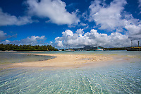 Ile aux Cerfs lagoon and white sand beach with beautiful boats and mountains in the background, Mauritius Island, Africa