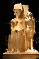 ITALIA - Torino - Museo Egizio  Il dio Amon con il faraone XVIII dinastia  regno di Horemheb 1319 - 1292 a.C. Tempio del dio Amon a tebe ai lati del trono geroglifici sull'unificazione dell'Alto e Basso Egitto ..L'iscrizione di Horemheb sembra essere un'usurpazione