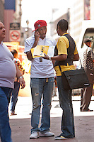An employee talks to a passer-by during a public event organized by NeighborWorks and Neighborhood Housing Services of New York City on Times Square in New York, NY, USA, to warn people against real estate loan scams, 4 June 2010.