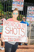 """People gather outside the Massachusetts State House for the No Mandatory Flu Shot MA demonstration in Boston, Massachusetts, on Sun., Aug. 30, 2020. The protest was organized in opposition to a newly-enacted law requiring most children in Massachusetts to receive flu vaccines this year as part of public health efforts during the ongoing Coronavirus (COVID-19) global pandemic. Some of those involved in this protest have been involved in the right-wing pro-Trump, pro-reopening protests organized by Super Happy Fun America during spring and summer 2020. <br /> <br /> The signs here read """"Parents call the shots / vaccine mandates have no place in a free country,"""" """"My child / my choice,"""" and """"Where there is risk there must be choice / No to government over reach."""""""