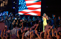 """May 2, 2002,FORT LAUDERDALE, Fla USA (AFIE) <br /> <br /> Members of the Band of the U.S. Air Force Reserve perform the song """"God Bless America"""" with singer Celine Dion on May 2, during the filming of the CBS prime-time special called """"""""Rockin' the USA -- A Salute to the U.S. Military,"""" which will air May 25 on CBS. <br /> <br /> <br /> (Mandatory Credit: U.S. Air Force photo)"""