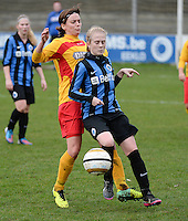 20140104 - AALTER , BELGIUM : Brugge's Silke Demeyere pictured with Massenhoven's Annelies Devliegher (l) during the female soccer match between Club Brugge Vrouwen and Massenhoven VC , of the 1/8 final matchday in the Belgian Women Cup competition. Saturday 4 January 2014 . PHOTO DAVID CATRY