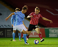 Lincoln City's Harry Anderson vies for possession with Manchester City U21's Callum Doyle<br /> <br /> Photographer Andrew Vaughan/CameraSport<br /> <br /> EFL Papa John's Trophy - Northern Section - Group E - Lincoln City v Manchester City U21 - Tuesday 17th November 2020 - LNER Stadium - Lincoln<br />  <br /> World Copyright © 2020 CameraSport. All rights reserved. 43 Linden Ave. Countesthorpe. Leicester. England. LE8 5PG - Tel: +44 (0) 116 277 4147 - admin@camerasport.com - www.camerasport.com