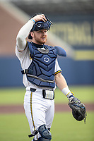 Michigan Wolverines catcher Griffin Mazur (13) in action against the Ohio State Buckeyes on April 9, 2021 in NCAA baseball action at Ray Fisher Stadium in Ann Arbor, Michigan. Ohio State beat the Wolverines 7-4. (Andrew Woolley/Four Seam Images)