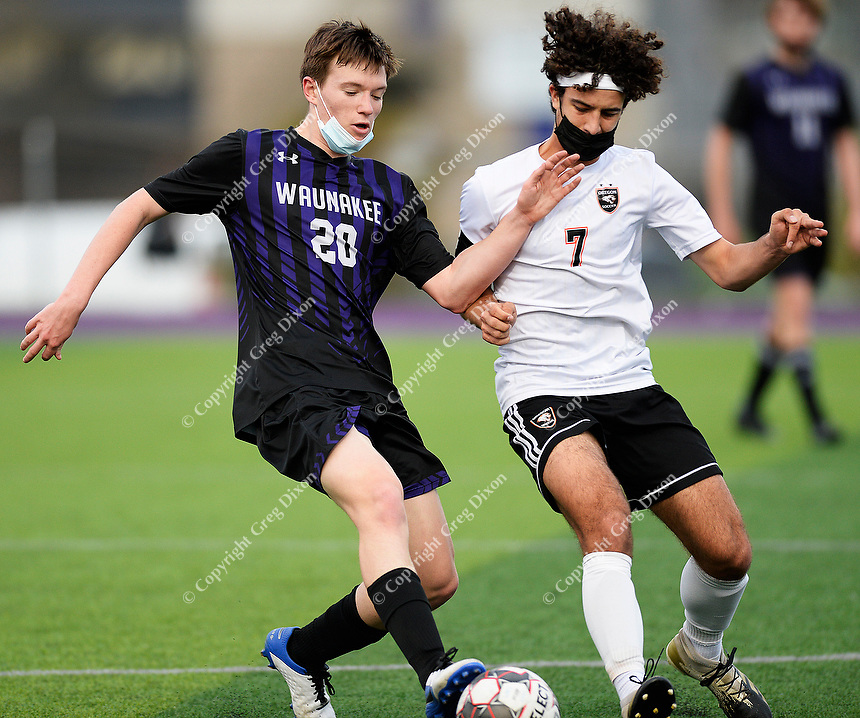Waunakee's Isaiah Jakel (20) and Oregon's Jayson Howard (7) fight for the ball, as Oregon takes on Waunakee in Wisconsin WIAA Badger Conference boys high school soccer on Tuesday, Apr. 27, 2021 at Waunakee High School | Wisconsin State Journal article front page C1 and C8 Sports Apr. 28, 2021 and online at https://madison.com/wsj/sports/high-school/soccer/isaiah-jakels-late-goal-lifts-waunakee-past-oregon-in-boys-soccer/article_50476402-c4fa-5f08-a2f1-dfbf24dad5fd.html