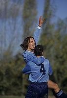 Men celebrating during a soccer game