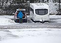 """28/03/16 <br /> <br /> Snow fall at Grin Low Caravan Site in Buxton. <br /> <br /> Holiday makers camping in the Derbyshire Peak District woke up to an unexpected white blanket this morning, thanks to Storm Katie.<br /> The covering of snow meant that many campers cut short their plans for a long weekend away, to brave the icy roads and head home early on Monday morning.<br /> But it wasn't all bad news for some of the younger guests at Grin Low Caravan Site in Buxton.<br /> Three-year-old Greta Williams made the most of the morning's surprise by building a snowman and enjoying snowball fights with her aunt Claire Jones. <br /> Claire said it was the first time she had been camping in the snow. <br /> """"It was completely unexpected but it's made it a trip to remember,""""she said. <br /> """"Greta really enjoyed making the snowman, but I think we'll head back home now in case any more falls.""""<br /> For Chris and Lorraine McCoy the first they knew of the snow was when they woke up and stuck their heads out of their tent.<br /> They had travelled to Buxton from Warwickshire with their four-year-old son Joe, to enjoy a weekend break.<br /> """"It's all part of the adventure,"""" said Chris. """"It's a bit cold in the tent but we'll soon warm up, and it's made the surrounding countryside really beautiful.""""<br /> <br /> All Rights Reserved: F Stop Press Ltd. +44(0)1335 418365   +44 (0)7765 242650 www.fstoppress.com"""