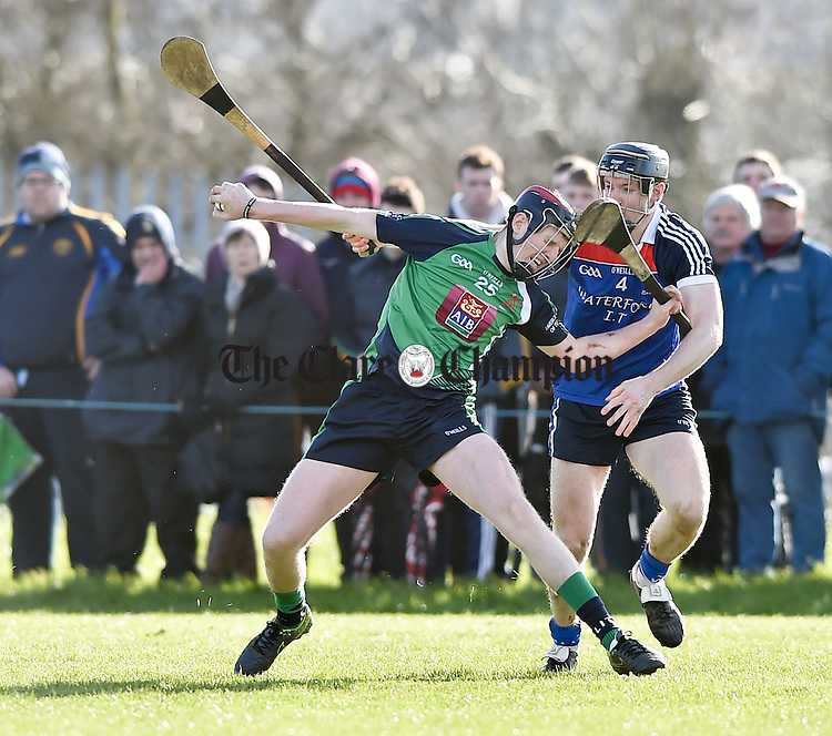 David Dempsey of LIT in action against Jerome Maher of WIT during their Fitzgibbon Cup quarter-final in Limerick. Photograph by John Kelly.