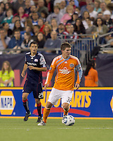 Houston Dynamo defender Bobby Boswell (32) dribbles. The New England Revolution defeated Houston Dynamo, 1-0, at Gillette Stadium on August 14, 2010.
