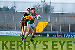 David Mangan, Mid Kerry in action against Michael Moloney, Dr. Crokes  during the Kerry County Senior Football Championship Semi-Final match between Mid Kerry and Dr Crokes at Austin Stack Park in Tralee, Kerry.