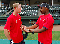 July 5, 2009: Hitting coach Billy McMillon (51), right, of the Greenville Drive talks with 2009 draft pick Jeremy Hazelbaker (15) prior to a game against the Savannah Sand Gnats at Fluor Field at the West End in Greenville, S.C. Hazelbaker, who played with Ball State, was a fourth-round 2009 draft pick of the Boson Red Sox. Photo by: Tom Priddy/Four Seam Images