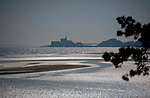 Swansea, UK, 25th March 2020.<br />The Mumbles headland during the stunning spring weather at Mumbles near Swansea this afternoon.